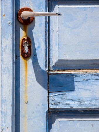 Old beautiful wooden door on Santorini island. Cyclades, Greece. Close up photo of texture