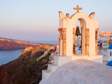 Church bell and Santorini island view on cave houses. Cyclades, Greece. Stok Fotoğraf - 148182274