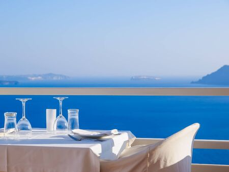 Open restaurant terrace with amazing sea view on Santorini island. Cyclades, Greece