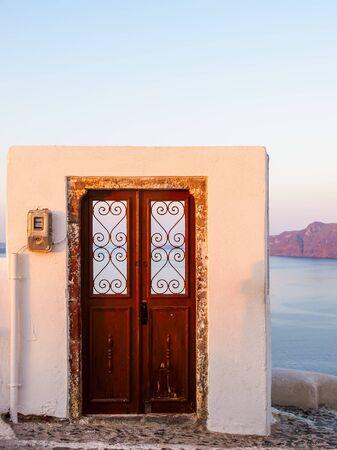 Wooden Door to nowhere. Santorini island view. Cyclades, Greece. Stok Fotoğraf