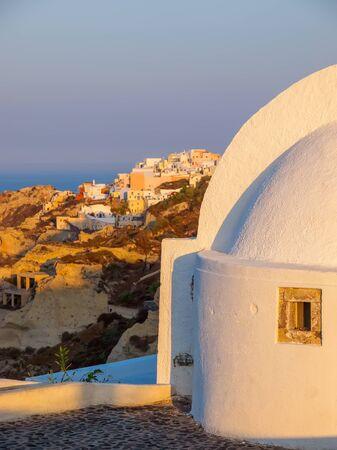 Amazing sunrise Santorini view with cave houses. Santorini island. Cyclades, Greece. Stok Fotoğraf