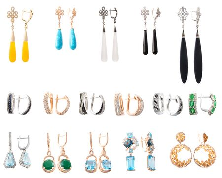 Stylish jewelry. Collection of earrings with gems isolated on white background Standard-Bild