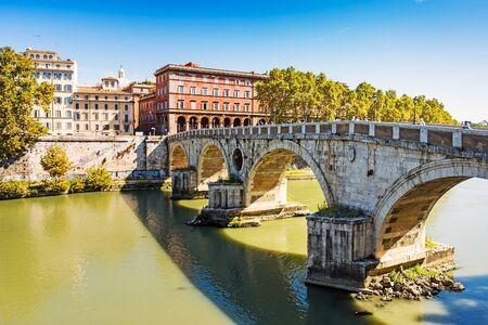 Antique Stone bridge in Rome. Rome is a famous tourist destination Archivio Fotografico