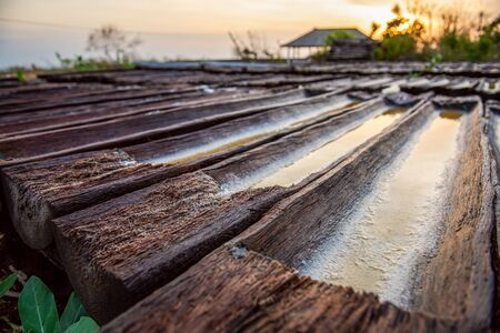 Salt farm. Making sea salt in Bali. Salt making process. Manufactures