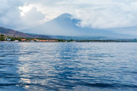 Beautiful balinese seascape view on volcano Agung in Amed village. Bali, Indonesia