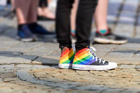 legs of young man in a sneakers with rainbow symbol of LGBT. LGBTQ+ Stok Fotoğraf