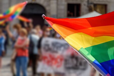 LGBT rainbow flag on foreground as a symbol of equality rights with blurred background. Equality rights for all people