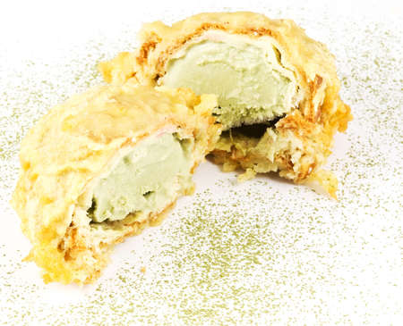 portion of fried ice cream, famous asian dessert on white background