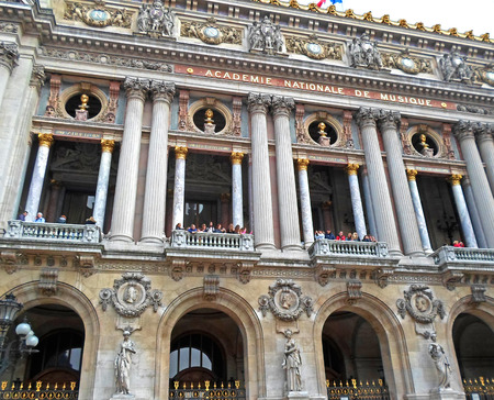garnier: People standing on the balcony The Palais Garnier (Paris Opera House) in Paris, France