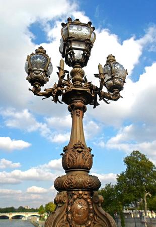 Historical street lamp on the Alexandre III bridge in Paris, France