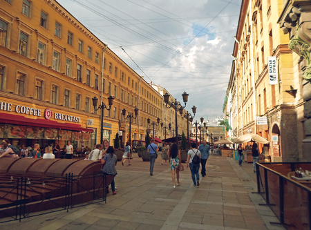 People walk on pedestrian street in the center of St. Petersburg on Malaya Sadovaya, Russia - July 2016