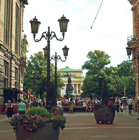 admire: People walk on pedestrian street in the center of St. Petersburg on Malaya Sadovaya, Russia - July 2016