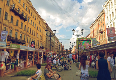 People walking through Summer book alley-2016, St. Petersburg, Russia - July 2016