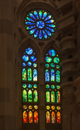 Geometric stained glass designs in Sagrada Familia windows, Barcelona, Spain. Each unit is named after a person or place of religious significance and relevance to the basilica. Editorial