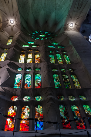 Geometric stained glass designs in Sagrada Familia window, Barcelona, Spain. Each unit is named after a person or place of religious significance and relevance to the basilica.