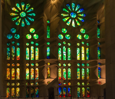 Green geometric stained glass designs in Sagrada Familia windows, Barcelona, Spain. Each unit is named after a person or place of religious significance and relevance to the basilica.