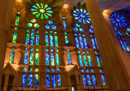 Blue and green geometric stained glass designs in Sagrada Familia windows, Barcelona, Spain. Each unit is named after a person or place of religious significance and relevance to the basilica.