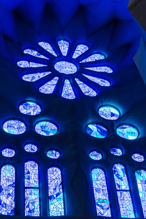 Blue geometric stained glass designs in Sagrada Familia window, Barcelona, Spain. Each unit is named after a person or place of religious significance and relevance to the basilica. Editöryel