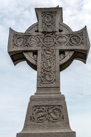 Barcelona, Spain - May 10, 2018: Celtic cross of the Poblenou cemetery. The Cross (1888) is a monumental cross pattée in Celtic style and is dedicated to the anonymous dead of the cemetery.