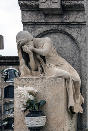 Sculpture of mourning crying woman on a grave in Poblenou Cemetery. Cemetery of Poblenou is today home to incredible sculptures, haunting, yet beautiful.