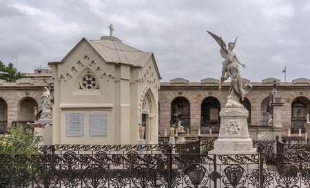 Barcelona, Spain - May 10, 2018: Crypts and sculptures on graves in Poblenou Cemetery. Peaceful but macabre, cemetery of Poblenou is today home to incredible sculptures, haunting, yet beautiful. 에디토리얼