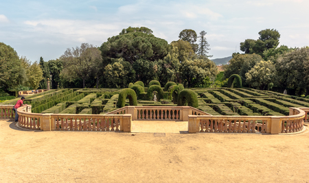 arcelona, Spain - May 10, 2018: Panoramic view on neoclassical-style Park of Horta. The hedge maze that gives the park its name, made up of 750 metres of trimmed cypress trees.