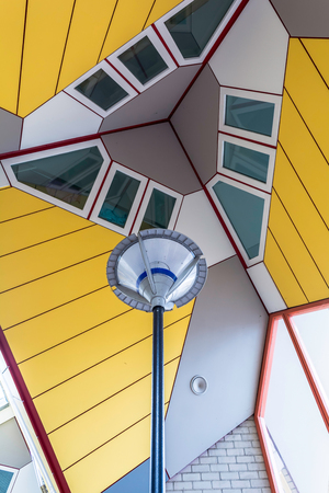 Street lamp under the Cube Houses in Rotterdam, Netherlands. It is a set of innovative houses based on the concept of high density housing with sufficient space.