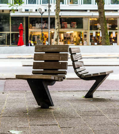 Practical and comfortable street furniture in Rotterdam, Netherlands. All these chairs can rotate on their axis and could be turned to any direction.