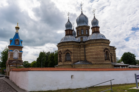 Jekabpils Orthodox Church of The Holy Spirit against cloudy sky. The church was built in the second part of the 19th century in Byzantine style. Its five domes have become a landmark of the city.