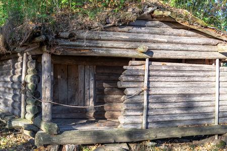 Old wooden log-crib dwelling of the ancient tribe of Latgallians in a reconstructed Stone Age settlement of Archaeological Site in Gauja National Park, Araisi, Latvia.