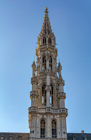 The tower of The Brussels Town Hall in Brabantine Gothic style with lavishly pinnacled octagonal openwork. Atop the spire stands gilt metal statue of the archangel Michael, patron saint of Brussels.