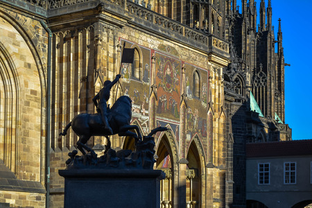 Statue of Saint George with St. Vitus Cathedral Golden Gate in the background