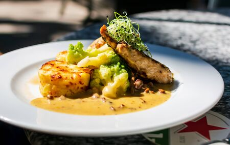 Chicken breast with chanterelle, fried potatoes, cauliflower and under cream sauce. Restaurant serving. Reklamní fotografie - 132285636