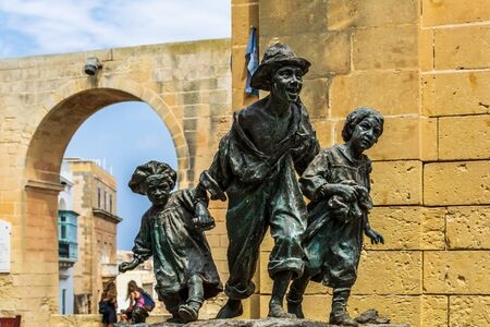 Valletta, Malta - August 30, 2019: Replica of the statue Les Gavroches (Street boys), which represents three poor street children roaming streets of Paris during tumultuous days of the 1848 revolution Redakční