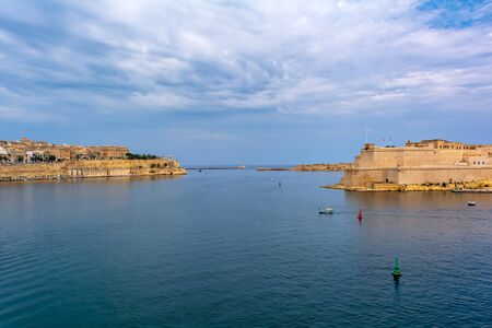 Valletta city and Fort St. Angelo in Birgu with Ricasoli Breakwater and Valletta Breakwater seen in the distance, all in one shot.