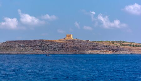 Saint Mary's Tower, or Comino Tower, shot from the water. Foto de archivo