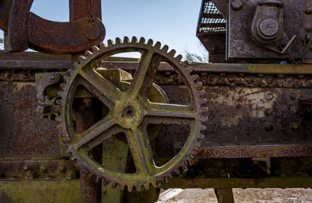 Closeup to the rusty gears on huge old cannon of Suomenlinna. These heavy cannons were constructed in Russia and placed on the earhtworks of Kustaanmiekka island.