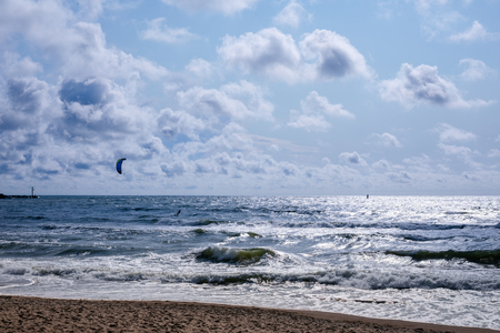 Empty beach, waves and dramatic sky at the Baltic sea shore line, Lithuania, Klaipeda