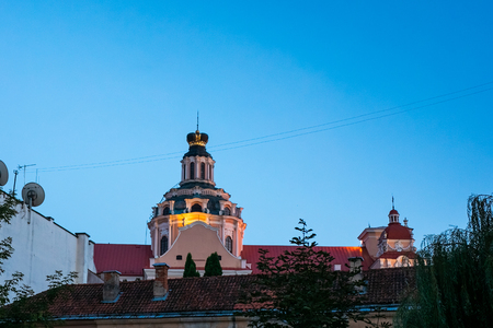 Church in Old Town at night of Vilnius, Lithuania, Baltic states. Stock Photo