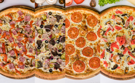 Photo collage with four different types of pizza. Standard-Bild