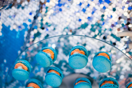 Candy bar, contains fruits, cup cakes, chocolate and another sweet desserts. Banquet service. Catering buffet style. Macaroons shell with pearls shares