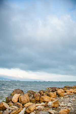 Stormy clouds under the Black sea. Themes bay in Novorossiysk in Krasnodar region, Russia. Image of sea trading port.