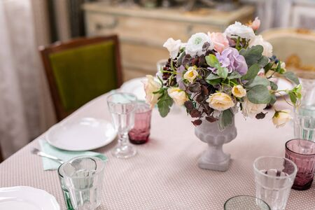 bouquet of flowers in a vase at the wedding table.