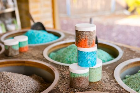Dead Sea colorful salt and scoop on a buckets at a souvenir shop in Kalia Beach, West Bank Stock Photo