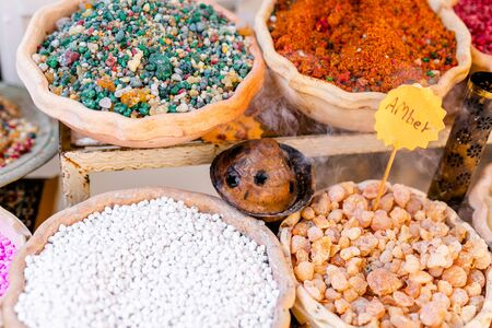 Spices, nuts and other food for sale at a market in the old city. Jerusalem, Israel, November 2019. Фото со стока
