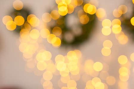 Christmas home room with tree and festive bokeh lighting, blurred holiday background. Banco de Imagens