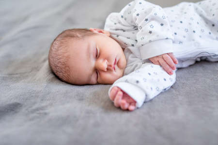 Baby boy sleeping first days of life. Cute little newborn child sleeping peacefully.