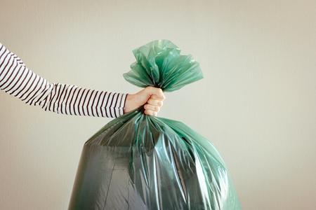 Man holding garbage bag. Stock Photo