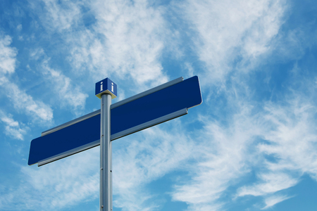 Blank directional road signs over blue sky with clouds.