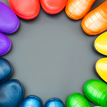 colorful rubber boots of all colors of the rainbow red orange